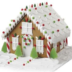 Light Up Christmas Night! Gingerbread House - Use the Gingerbread Candy Kit to decorate a house Santa can't miss! Add color and fun to your gingerbread centerpiece with the candy rounds, light bulbs, peppermint sticks and jelly trees in the kit. Gingerbread House Designs, Gingerbread House Parties, Christmas Gingerbread House, Christmas Treats, Christmas Baking, Christmas Cookies, Christmas Decorations, Gingerbread Houses, Gingerbread House Decorating Ideas