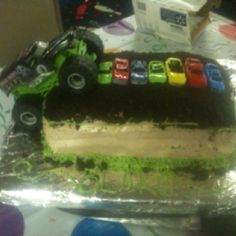 """Birthday Cake: Monster Truck Used cheap dollar store cars to smash and put on cake and crushed chocolate cream Oreos for """"dirt"""""""