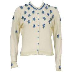 1950's Pringle of Scotland Cream Cardigan with Blue Flowers | From a collection of rare vintage sweaters at https://www.1stdibs.com/fashion/clothing/sweaters/