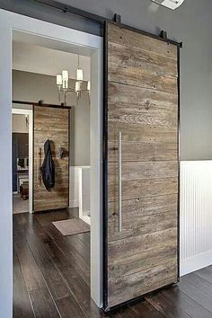 // love these industrial sliding doors. Would need to be well-balanced of course.