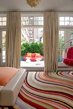 Spice up your neautral colored furniture with a bold carpet!   See More: http://www.pinterest.com/citytile/