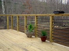 DIY Deck Railing Ideas & Designs That Are Sure to Inspire You If your favorite outdoor space is your deck, we give you over 14 inspiring Deck Railing Ideas to show how you can spruce it up, from DIY to store bought. Rebar Railing, Patio Railing, Glass Railing, Wood Patio, Railing Planters, Deck Railing Ideas Diy, Handrail Ideas, Decking Material, Front Deck