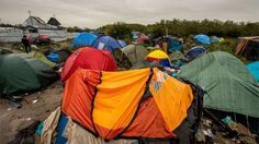 """Calais migrants to be given heated tents, as police numbers rise  Migrants"""" tents are pictured in the """"New Jungle"""" migrant camp in Calais, where thousands of migrants live in the hope of crossing the Channel to Britain, on 21 October 2015."""