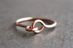 HOLDING HANDS Wire Ring in rose gold, yellow gold and silver ... from muyinjewelry.com