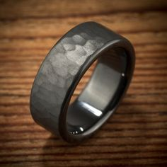 Men's handmade hammered rustic jet black zirconium wedding ring by Spexton Custom Jewelers.