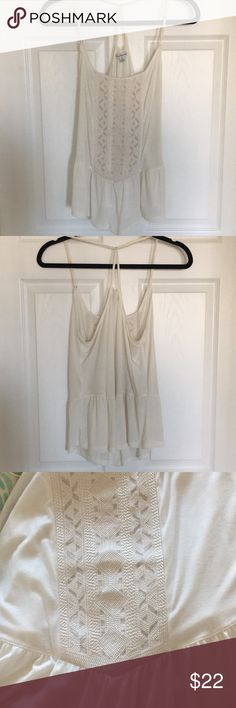 American eagle beautiful white tank size L American eagle beautiful white tank size L. T strap back. Strap is suede. Peplum like design and detailed stitched pattern American Eagle Outfitters Tops Tank Tops