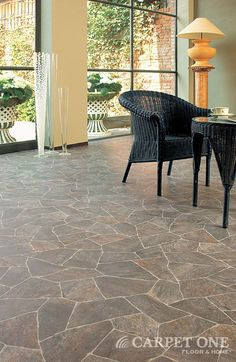 Looks like flagstone...but, it's vinyl!  Learn more about Vinyl floors from Carpet One Floor & Home.