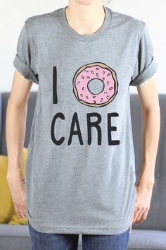 I Donut Care Design printed on a light grey heather unisex tshirt  SIZE- • Refer to 2nd photo for shirt measurements • Shirt modeled above is a size