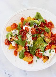 Slowly roasted cherry tomato salad over pouches of burrata cheese, topped with a zesty scallion lemon dressing.