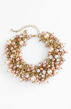 Love the decadent cluster of shimmering pearls and round crystals on this bracelet.