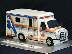 Ambulance cake I made for a young man who had dreamed of becoming a Paramedic his entire life, and has completed his registration exams. He completed much of his training on this St. John's Ambulance M6. thanks for looking. :)