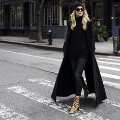 Blair Eadie pairs all black with her luxe leopard Corsa boots.