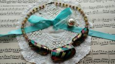 Check out this item in my Etsy shop https://www.etsy.com/listing/497665083/retro-1980s-wooden-necklace-with-hand