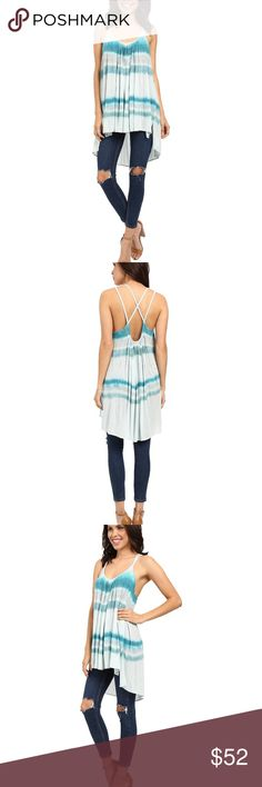 "NEW Free People Small Aqua Tie Dye Fly By Tank NWT NEW Free People Size Small Aqua Marine Tie Dye Fly By Away Tank NWT $78   New with Tags  Purchased at Nordstrom  Lightweight jersey fabrication Cross strap detail at back  Scoop neck Sleeveless Side vents High-low hemline Approx. 30"" shortest length, 35"" longest length  92% modal, 8% spandex Hand wash cold Free People Tops Tank Tops"