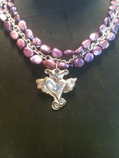 Fine silver handmade pendant on purple coin pearl and silver chain necklace.