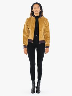 An updated, flight silhouette constructed from wide, 8 wale corduroy for plush texture and extra warmth. The Bessette Jacket features a heavyweight remake of the popularized bomber jacket with thick, 100% cotton corduroy fabrication, zipper closure, side pockets, cinched waistband, and contrast ribbed collar, sleeve cuffs, and waistband. This jacket fits snug around the waist with a loose, yet structured, upper. Size up for a more relaxed fit.