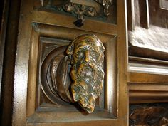 old man face carved into a door knob.  so awesome.