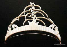 An unusual ivory tiara, Dagobert Peche, 1916. Carved in the likeness of a plant with berries and leaves.
