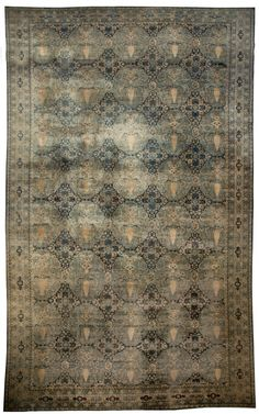 An oversized antique rug. The avarage price is $50,000. For more detailed info go to: http://www.dorisleslieblau.com/antique-rugs/oversized-rugs