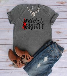 You will fall in LOVE with our super soft and comfortable shirts! Grey t-shirt with plaid Christmas tree, jeans.