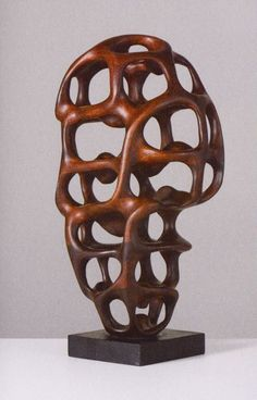 Untitled (1978) by Italian-born US-based sculptor and designer Mario Dal Fabbro (1913-1990). Carved wood, tabletop size. via Mondoblogo