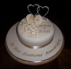 - Diamond anniversary cake. Fruit cake with cream and gold hand made flowers x