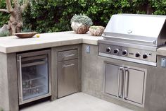 Built in BBQ, Smooth Stucco Face and a Colored Concrete Countertop