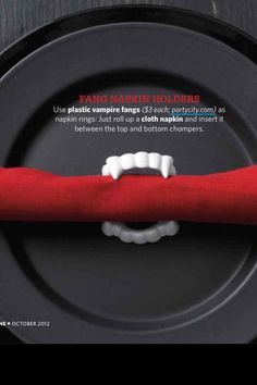 Use vampire teeth as napkin holders. | 27 Incredibly Easy Ways To Upgrade Any Halloween Party