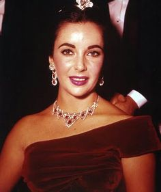 8. Elizabeth Taylor, wearing a necklace of rubies and diamonds.