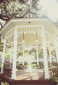 Hanging Pomander Balls on the gazebo and maybe on shepard hooks down the isle?