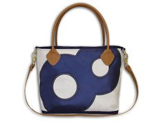 Add a little nautical chic to your everyday outings. This handbagis made with recycled sailcloth and genuine leather for a touch of sophistication. The brass hardware adds apop of metallic while the detachable shoulder strap keeps this bag versatile,functional and stylish. Please note that eachbag is designed with a range of numbers and the current line is availble with single digits only. If you would like your bag to display a specific number, a custom bag may be created for you at an…