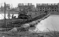 A couple of M4 Sherman 2 Armoured Division crossed the Roer River in the devastated town of Julich, on February 26, 1945