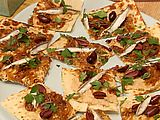 Flatbread with White Bean Hummus, Caramelized Onions -- drop the olives and anchovies, add peppers