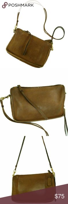 Authentic Vintage Coach made in New York crossbody This amazing bag in British Tan is in excellent condition. It is authentic and all my pictures are of the actual product. This bag can be used crossbody style or as a wristlet. Has the original key fob/hang tag. Very hard to find. Coach Bags Crossbody Bags