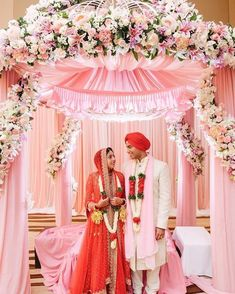 Pink floral mandap decor, lavender wedding decor, red bridal lehenga, white sherwani for groom to be, couple portrait Indian Wedding Stage, Indian Wedding Planner, Indian Weddings, Destination Wedding, Mandap Design, Flower Wall Wedding, Floral Wedding, Lavender Decor, Wedding Hall Decorations