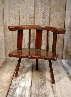 Hewn from oak, with a single slab seat it stands on three legs and has a back rail fashioned from a single bough. Traces of historic green paint, superb patina. A rare example of a small group of chairs haling from west Wales. Cardiganshire. Early- mid C18th. Height- 72cm (28 1/2) Width of seat 65cm (25 1/2) Depth- 39cm (15 1/2)