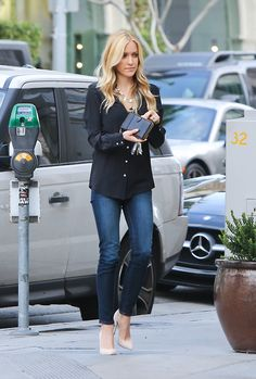 Love the black blouse, skinny jeans, and nude pumps