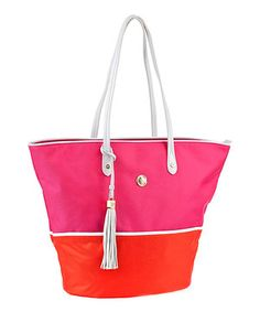 The right bag has the perfect mix of personality and function, and this is it. This beachy tote in color blocked nylon features a roomy design outfitted with dual leather handles and accented with a leather fringe tassel. To keep all those must-haves tucked safely out of sight, the interior includes a zip pocket, open pocket and cell phone pocket.
