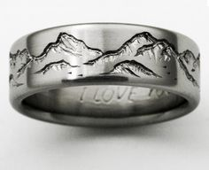 Seriously though.... @Brittiful2014 Titanium ring with carved mountain range surrounding the ring. Example is 8 mm, size 10.75. Second example is 4 mm, size 7. The four views are 8 mm, size 10.5