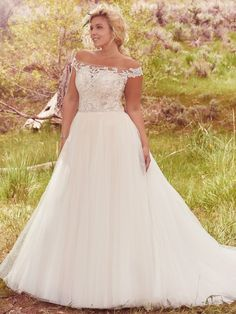 Maggie Sottero - MONTGOMERY, A delicate illusion off-the-shoulder neckline coupled with a dramatic illusion lace back create glamour in this alluring ball gown plus size wedding dress with delicate lace bodice and flowing tulle skirt, accented with a feminine Swarovski crystal belt. Finished with crystal button over zipper closure.