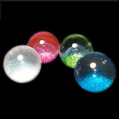 """These Fun Bouncy Balls are filled with liquid and glitter making them your not so ordinary Bouncing Ball! Keep them Bouncing and watch the glitter inside sparkle. Throw the Crystal Ball in the air, catch it, and watch the glitter swirl around. When the glitter settles turn it upside down and watch the glitter fall and make a mesmerizing cloud burst effect. Approximately 2.5"""" wide. For ages 3 and up. Price is for 1 Crystal Ball of your color choice."""
