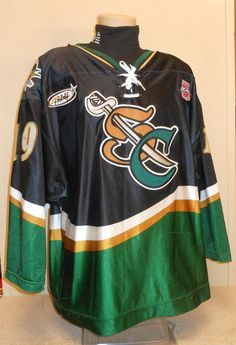 Worn during the 03-04 season by Troy Brummett. This season marked the 25th Anniversary of the USHL. Each team sported the special anniversary patch on home and away jerseys that season.  This was the last season of the SC logo.  Troy logged a single season as a Musketeer notching 18 goals and 20 assists.