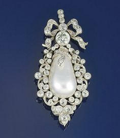 Circa 1890 Edwardian diamond and blister pearl pendant.  The drop-shaped blister pearl with applied diamond and rose-cut diamond serpent, to an old-cut diamond scroll border, old brilliant-cut diamond collet surmount and old-cut diamond bow top with three stone pendant loop.