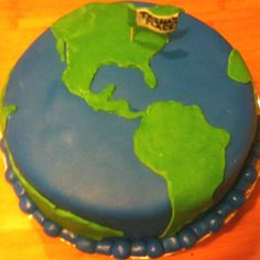 A world cake made for a travel themed housewarming party