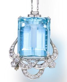 An aquamarine and diamond pendant/brooch  centering a cut-cornered rectangular-cut aquamarine, with foliate round brilliant and single-cut diamond motifs, accentuated by baguette-cut diamonds, together with a delicate chain; estimated total aquamarine weight: 48.00 carats; estimated total diamond weight: 1.20 carats; pendant mounted in platinum; chain in fourteen karat white gold; length of pendant: 1 3/4in.; length of chain: 18in.
