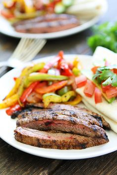 Grilled Steak Fajitas Recipe on twopeasandtheirpod.com Get out the grill and make these easy and delicious fajitas for dinner! Serve with tortillas and your favorite toppings!