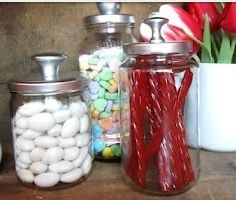 Spray paint tops of spaghetti sauce jars, pickle jar etc.and screw on drawer handles for decorative jars