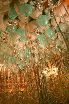 mint & gold helium filled balloons, with ribbons hanging from said balloons