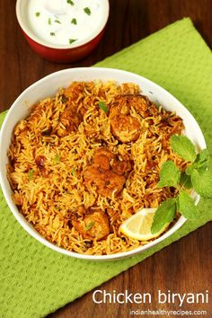 chicken biryani is a delicious one pot dish where chicken is cooked with fragrant rice & spices. chicken biryani is a delicious one pot dish where chicken is cooked with fragrant rice & spices. Chicken Biryani Recipe Hyderabadi, Easy Chicken Biryani Recipe, Biryani Chicken, Chicken Recipes Video, Chicken Byriani Recipe, Veg Biryani, Indian Food Recipes, Asian Recipes, Healthy Recipes