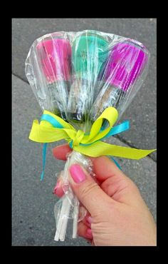 Nail polish lollipops. A great gift idea. Tape candy stick to the tops of the nail polish, bundle and then wrap in together with some ribbon. Cute idea!